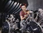 Riveter Woman Working on Wires of a Motor