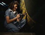 Riveter Woman Working on a Consolidated Bomber