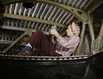 Woman Riveting an A-20 Bomber