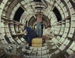 Three Women Riveters Working Inside a Circular Structure of the Fuselage