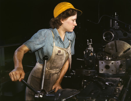 Free Photo: Female Riveter Lathe Operator Machining Parts for Transport Planes